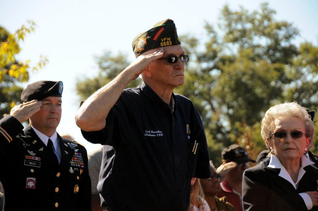 Photograph of a veteran saluting
