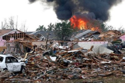burning building and ruins after tornado hit oklahoma