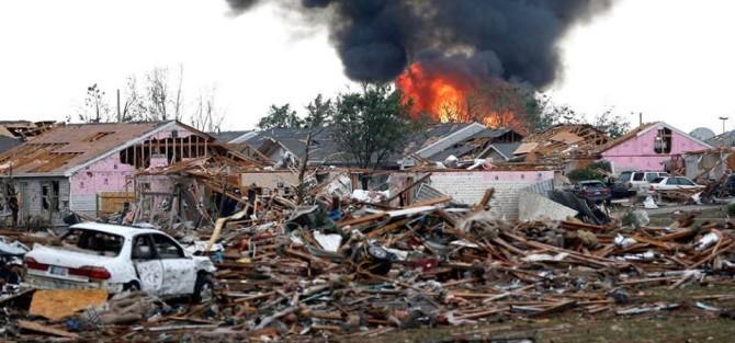 burning building and ruins after tornado hit oklahoma
