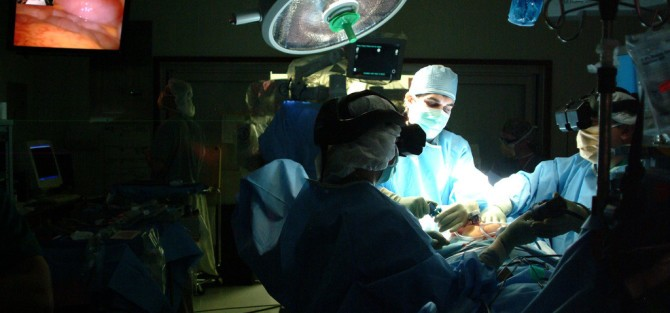 Surgeon and staff performing surgery