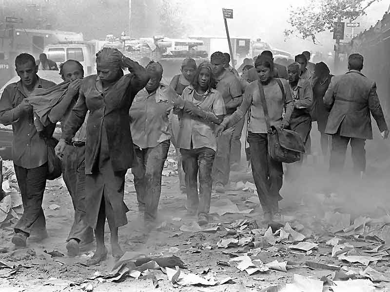 picture of people walking through dust