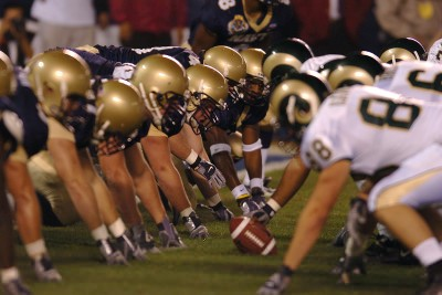 The U.S. Naval Academy Midshipmen, based in Annapolis, Md., position themselves defensively in prepartion for a play by the Colorado State Rams.