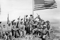 US soldiers celebrating next to an American flag