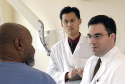 image of patient with two doctors