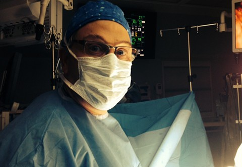 Dr. Avi Lebenthal in scrubs and surgical mask
