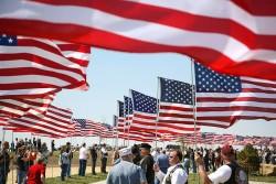 Veterans holding american flags