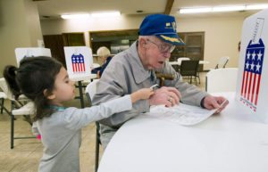 WWII Veteran Casts Ballot with Great Granddaughter
