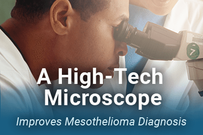 Man looking into microscope