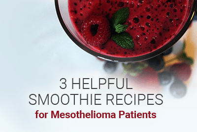 Image of glass with smoothie and fruit in it. Fruit around the bottom of the glass. Reads: 3 Helpful Smoothie Recipes for Mesothelioma Patients.