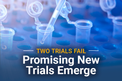 Test tubes with title: Two Trials Fail Promising New Trials Emerge