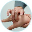 Image of someone getting acupuncture therapy in the form of pressure applied to their hand.