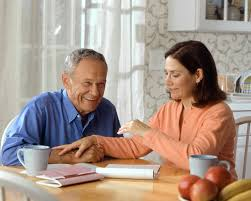 Image of caregiver talking to the person they are caring for.
