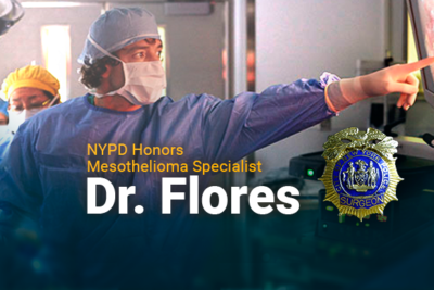 Image of Dr. Flores pointing. Image reads: NYPD Honors Mesothelioma Specialist Dr. Flores