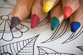Coloring book page and coloring pencils