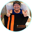 Image of a cancer patient with a thumbs up, cancer down power up pack