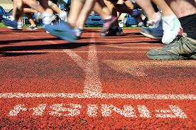 Group of runners crossing a finish line