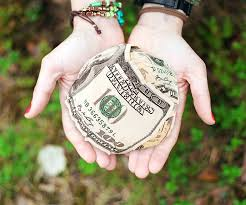 Image of hands holding money